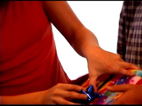 brother and sister wrapping gift - bald head island stock videos & royalty-free footage