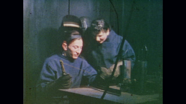brother instructs sister in welding - narrating stock videos & royalty-free footage
