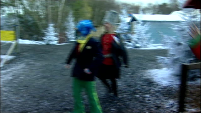 brothers convicted over lapland new forest winter theme park lib ext lapland staff in snowman and other costumes dance around at entrance family... - new forest stock videos and b-roll footage