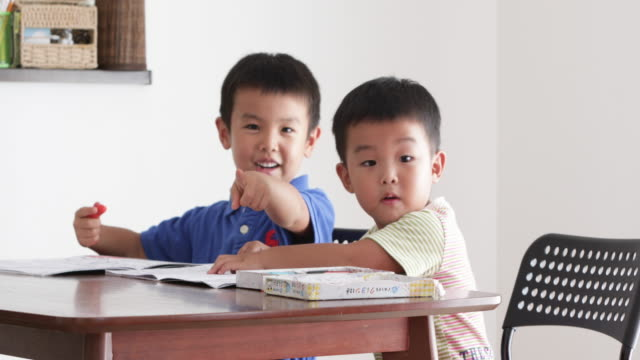 brothers drawing on the table. - childhood stock videos & royalty-free footage