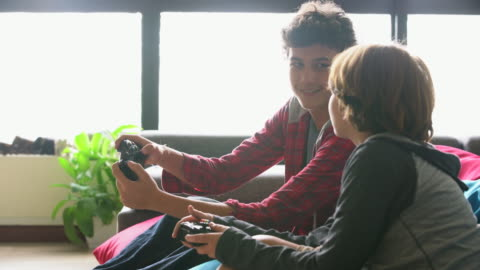 ms brothers playing video games together at home. - teenage boys stock videos & royalty-free footage