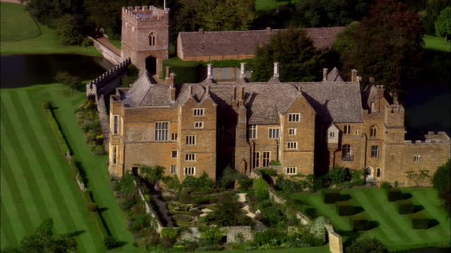 aerial, broughton castle, oxfordshire, england - oxfordshire stock videos & royalty-free footage