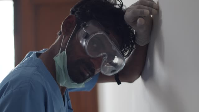 brown asian doctor healthcare worker wearing a surgical mask for protection against  covid-19 coronavirus - latex glove stock videos & royalty-free footage
