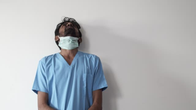 brown asian doctor healthcare worker wearing a surgical mask for protection against  covid-19 coronavirus - covering stock videos & royalty-free footage