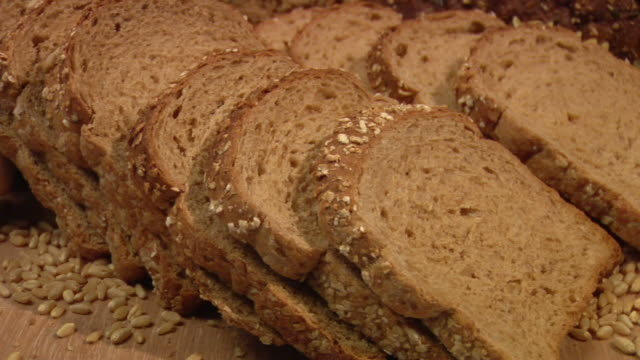 cu, pan, brown bread slices - bread stock videos and b-roll footage