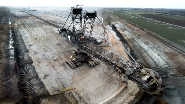 aerial: brown coal excavator - excavator stock videos and b-roll footage
