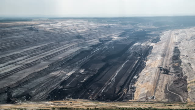 aerial: brown coal surface mine - coal mine stock videos and b-roll footage