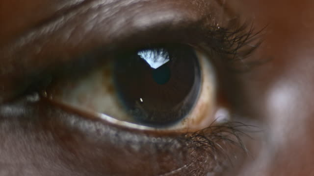ecu brown eye of an african-american person - brown stock videos & royalty-free footage