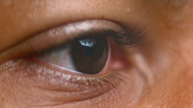 ecu brown eye opening - human eye stock videos & royalty-free footage
