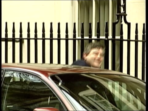 brown increases borrowing in prebudget statement downing street gordon brown mp out of number 11 into car which drives along cs fence post pull focus... - borrowing stock videos & royalty-free footage
