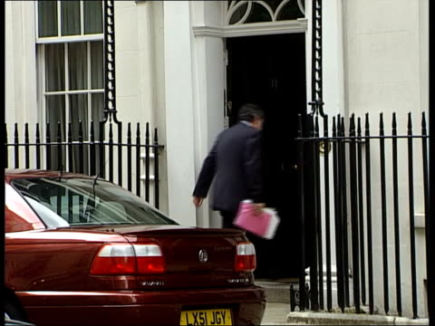 brown insists on 5 economic tests itn london downing street chancellor gordon brown mp into number 11 gv number 11 downing street la ms door to... - number 11 stock videos and b-roll footage