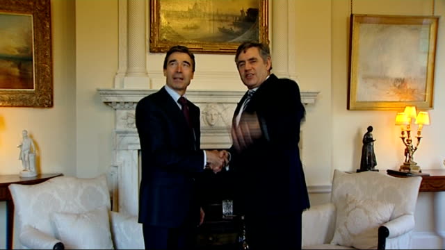 brown meets nato secretary general at downing street; england: london: downing street: int gordon brown mp enters room with anders fogh rasmussen and... - secretary general stock videos & royalty-free footage