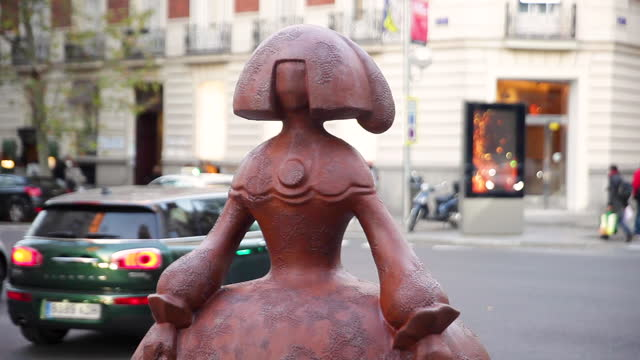 brown menina figure designed by spanish fashion designers devota & lomba and sponsored by the madrid city council stands at the intersection of... - spotted stock videos & royalty-free footage