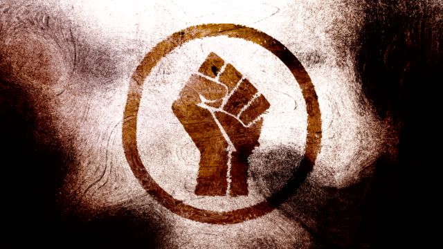 Brown raised fist symbol on a high contrasted grungy and dirty, animated, distressed and smudged 4k video background with swirls and frame by frame motion feel with street style for the concepts of solidarity,support,human rights,worker rights,strength