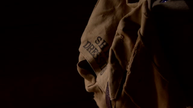a brown satchel reading 'shell dressings' hangs inside a wwi trench dugout, northern france. - satchel stock videos & royalty-free footage