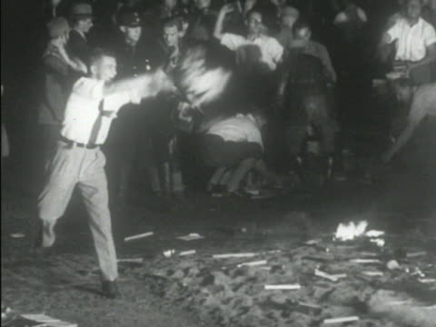 brown shirt standing in front of shop men throwing books into fire views of german village meeting of local nazi party checking list of names to... - judaism stock videos & royalty-free footage