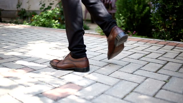 brown shoes on male legs - human foot stock videos & royalty-free footage