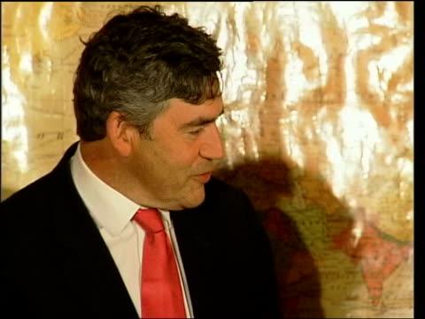 brown wants debt repayments frozen for affected countries/charity record date side cms gordon brown mp talking gordon brown shaking hands with woman... - john w. snow politician stock videos and b-roll footage