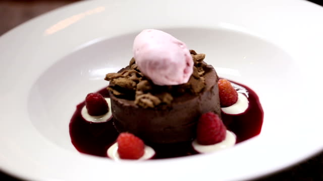 brownies with ice cream and raspberry - mint leaf culinary stock videos and b-roll footage