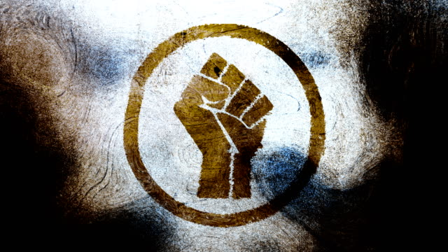 Brownish raised fist symbol on a high contrasted grungy and dirty, animated, distressed and smudged 4k video background with swirls and frame by frame motion feel with street style for the concepts of solidarity,support,human rights,worker rights,strength