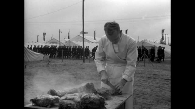 stormtroopers 'brownshirts' carrying nazi swastika banners in parade army cook cutting meat camp bg troops eating at outdoor tables young males w/... - nazi brown shirts stock videos & royalty-free footage