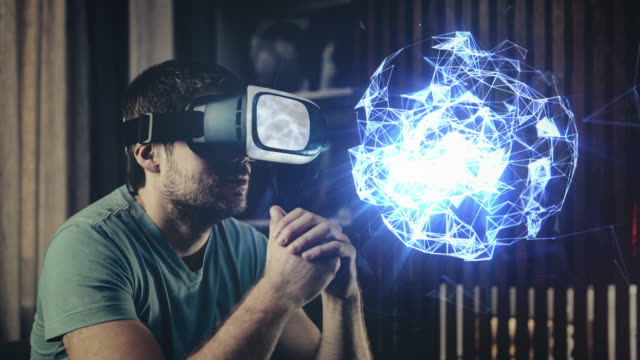 browsing a holograms in virtual reality glasses - safety glasses stock videos & royalty-free footage
