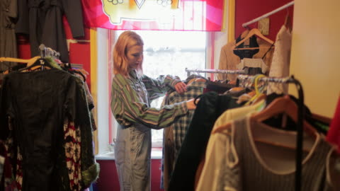 browsing at a thrift store - shopping stock videos & royalty-free footage