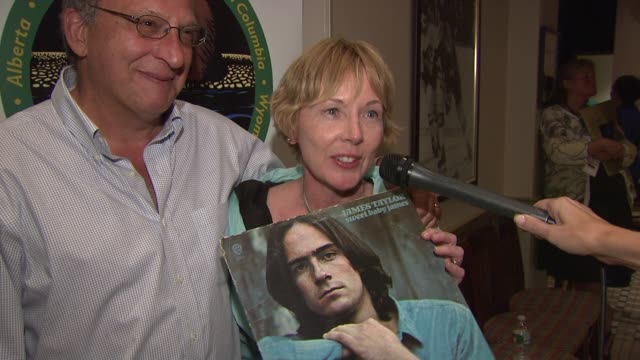 bruce and karen morris talking about bringing a james taylor album for him to sign at the carole king james taylor raise over 13mm donation with... - bruce stock videos & royalty-free footage