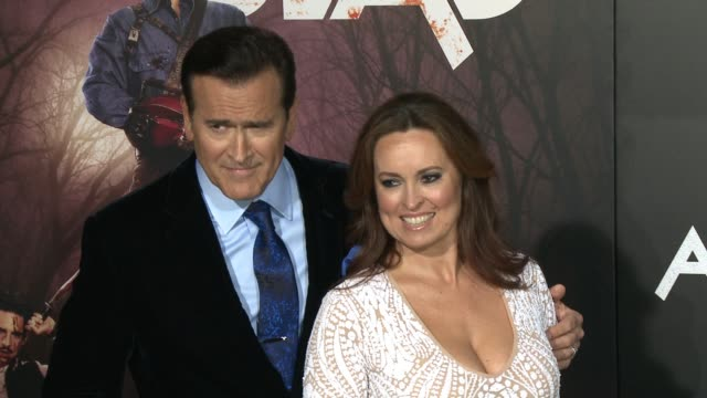 """bruce campbell and ida gearon at the """"ash vs. evil dead"""" los angeles premiere and live performance by iggy pop at tcl chinese theatre on october 28,... - bruce campbell stock videos & royalty-free footage"""