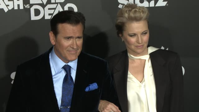 """bruce campbell and lucy lawless at the """"ash vs. evil dead"""" los angeles premiere and live performance by iggy pop at tcl chinese theatre on october... - bruce campbell stock videos & royalty-free footage"""