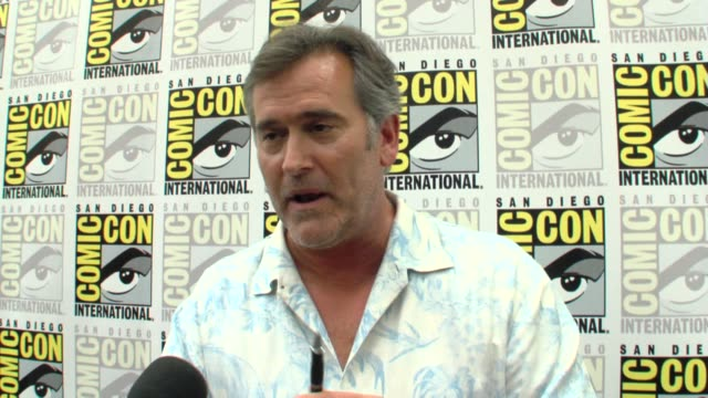 bruce campbell jokes about his character using a pen to save the day at the comic-con 2009: bruce campbell interview at san diego ca. - bruce campbell stock videos & royalty-free footage
