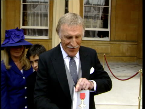 presenter bruce forsyth posing for photocall with obe - order of the british empire stock videos and b-roll footage