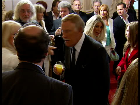 stockvideo's en b-roll-footage met bruce forsyth speech/unveiling bust england london london palladium int bruce forsyth chatting to guests with wife wilnelia merced / good close up... - london palladium