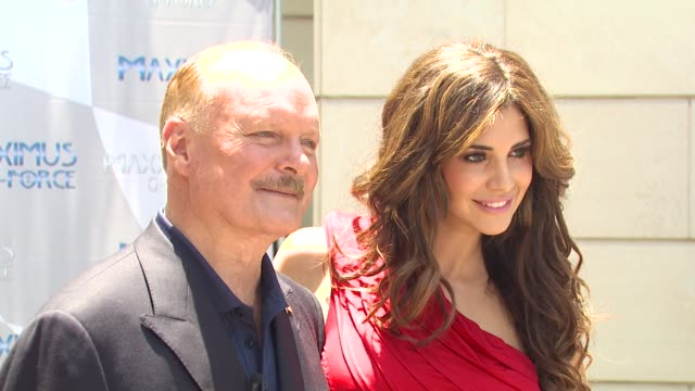 bruce mcmahan and playmate of the year hope dworaczyk at the new and improved maxximus g force the world's fastest car unveiled at beverly hills ca - mahan stock videos & royalty-free footage