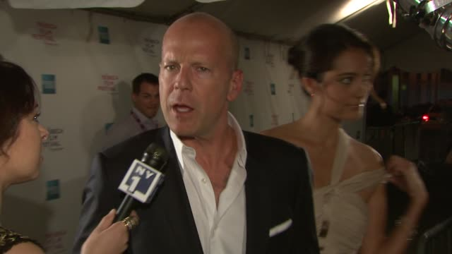 bruce willis and emma heming at the 7th annual tribeca film festival from within premiere at the lowes at 19th and broadway in new york new york on... - bruce willis stock videos and b-roll footage
