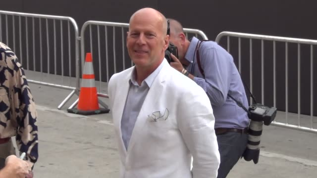 Bruce Willis greets fans at the Westwood Village Theatre in Westwood 07/11/13 Bruce Willis greets fans at the Westwood Village on July 11 2013 in Los...