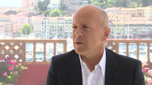 bruce willis on the directors he wants to work with at moonrise kingdom interviews 65th cannes film festival at carlton beach on may 17 2012 in... - bruce willis stock videos and b-roll footage