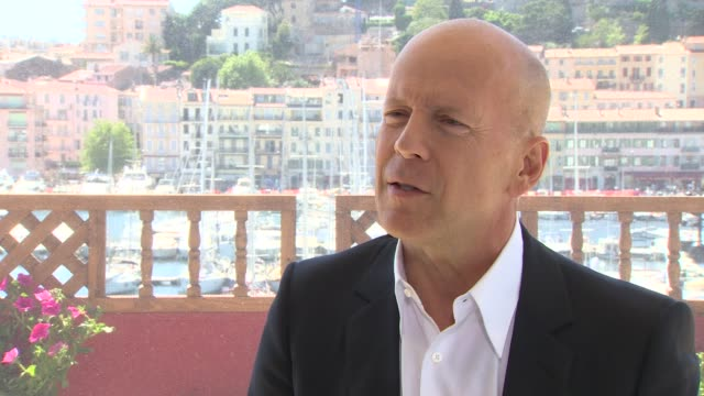 bruce willis on the filming experience at moonrise kingdom interviews 65th cannes film fest on may 17 2012 in france - bruce willis stock-videos und b-roll-filmmaterial