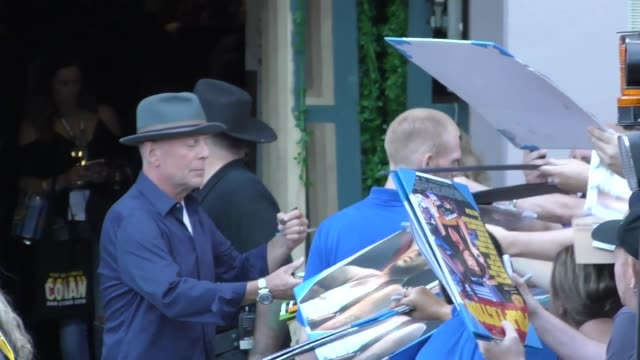 bruce willis signs autographs for fans outside 'conan' at spreckels theatre at san diego comiccon international 2018 at celebrity sightings at... - autographing stock videos & royalty-free footage