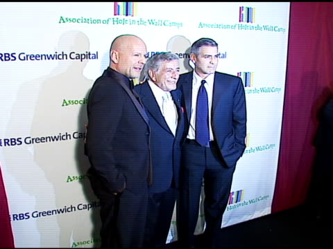bruce willis tony bennett and george clooney at the singers and songs celebration of tony bennett's 80th birthday by raising funds for newmans 'hole... - tony bennett singer stock videos and b-roll footage