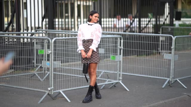 bruna marquezine wears earrings a white lace embroidered top a skirt a balck bag with fringes black boots a small bow tie outside miu miu club 2020... - boot stock videos & royalty-free footage