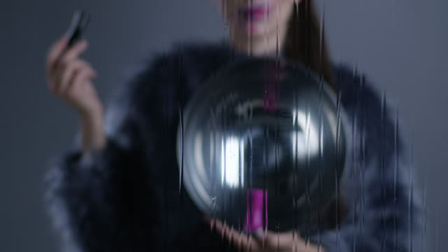 brunette fashion model in fur holds silver platter and bottles of nail polish, black and pink. fashion video. - silver platter stock videos and b-roll footage