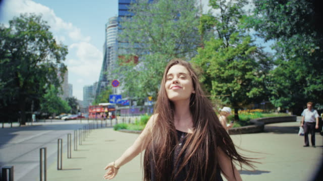 brunette girl in big city. - warsaw stock videos and b-roll footage