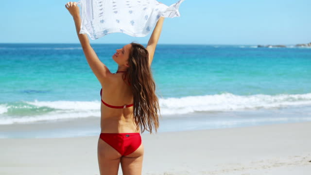 Brunette holding her sarong