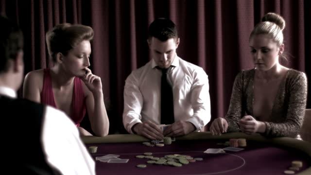 stockvideo's en b-roll-footage met brunette man winning against two girls - overhemd en stropdas