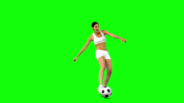 Brunette playing soccer in slow motion