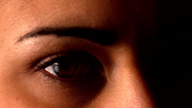 brunette woman blinking on black background - eyelash stock videos & royalty-free footage
