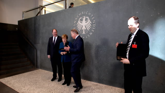 Bruno Kahl President of the Federal Intelligence Service BND hands over a signet to German Chancellor Angela Merkel and Head of the German...