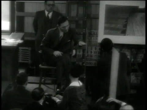 stockvideo's en b-roll-footage met bruno richard hauptmann, accused killer of charles lindbergh's infant son, taking the stand in his own defense / new jersey, united states - 1935