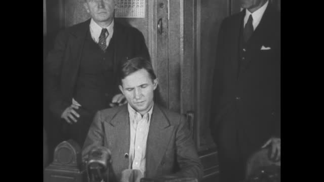 Bruno Richard Hauptmann seated in custody accused with kidnapping Charles A Lindbergh Jr the Lindbergh Baby